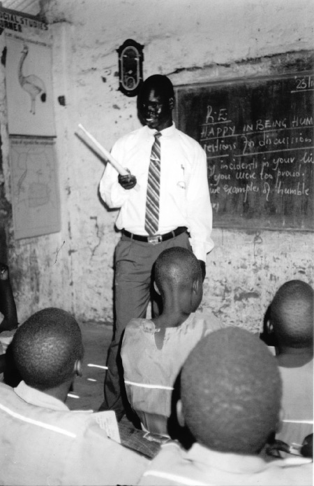 Joseph Massima teaching in a refugee camp